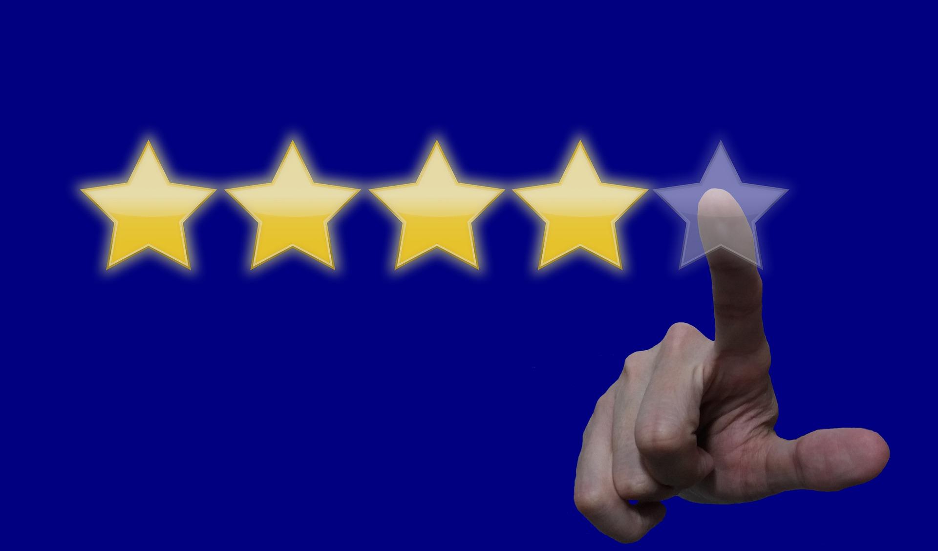 星を指さす手